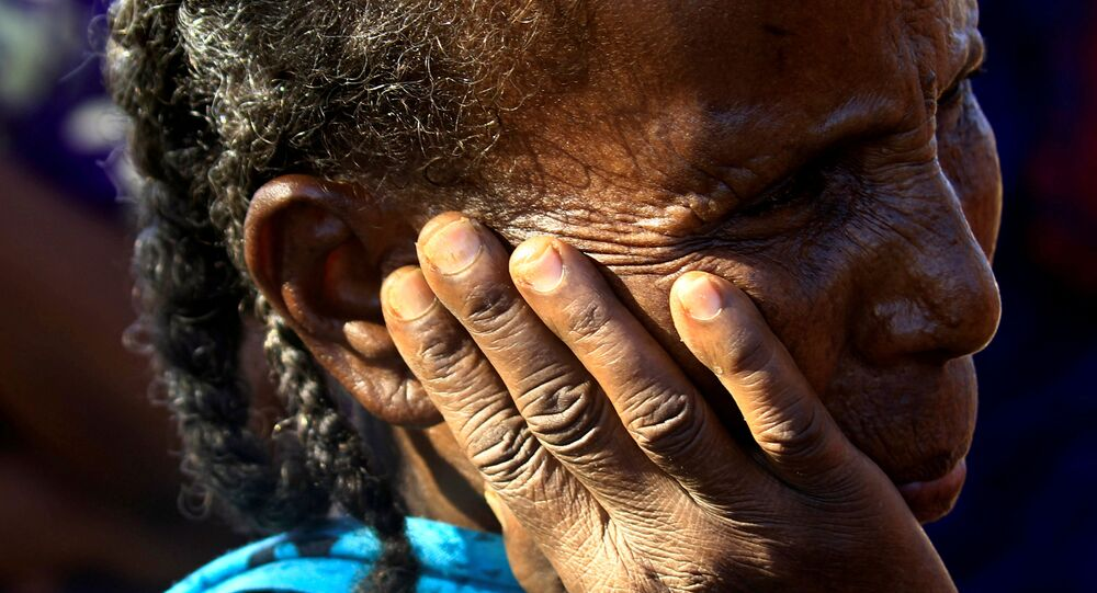 FILE PHOTO: An Ethiopian refugee woman who fled Tigray region, is seen within the Um-Rakoba camp in Al-Qadarif state, on the border, in Sudan December 11, 2020