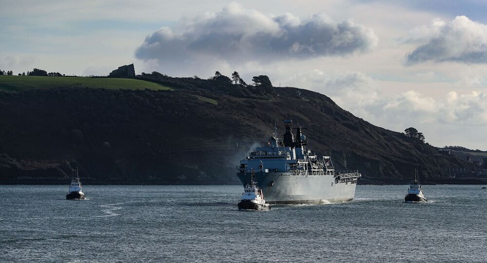 A tugboat pulls the HMS Albion out of Plymouth Sound