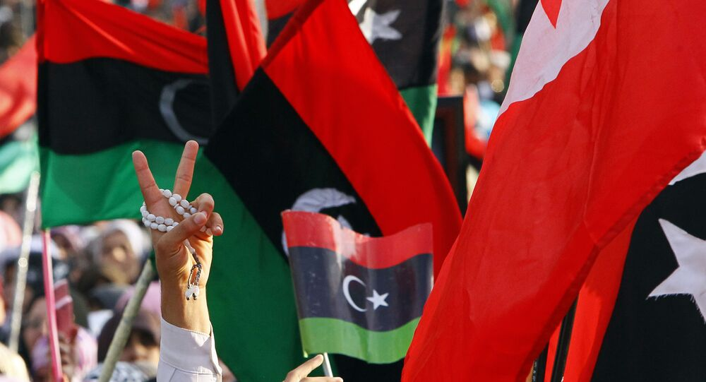A Libyan flashes the V sign to celebrate at Saha Kish Square in Benghazi, Libya, 23 October 2011 as Libya's transitional government declares the liberation of Libya after months of bloodshed that culminated in the death of longtime leader Moammar Gaddafi.