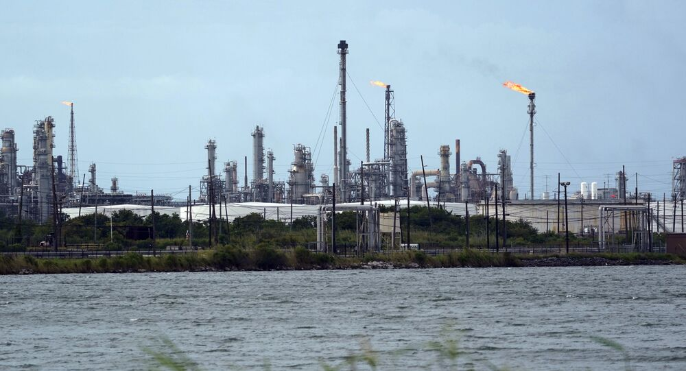 A refinery is seen along the water, Wednesday, Aug. 26, 2020, in Port Arthur, Texas.