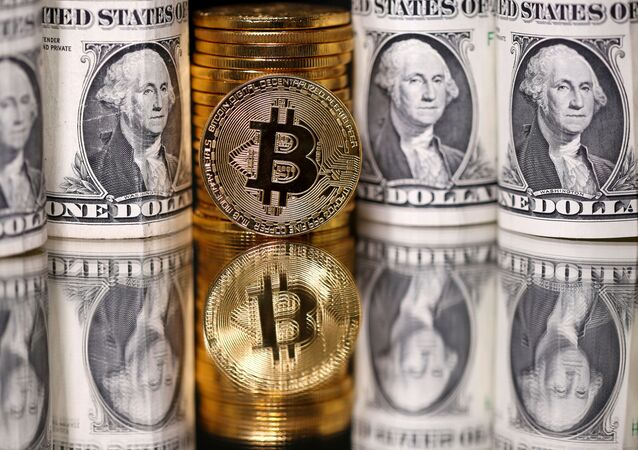 Representations of Bitcoin and U.S. dollar banknotes are seen in this illustration taken January 6, 2020.