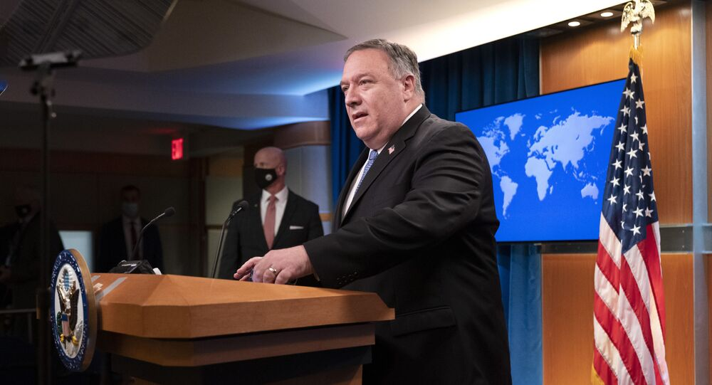 Secretary of State Mike Pompeo arrives to speak during a media briefing, Tuesday, Nov. 10, 2020, at the State Department in Washington.