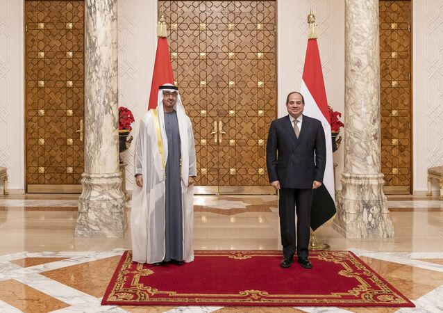 Egypt's president, Abdel Fattah Al-Sisi, and Abu Dhabi's Crown Prince and Deputy Supreme Commander of the United Arab Emirates Armed Forces Mohammed bin Zayed Al Nahyan, pose for a photo during the prince's visit to Cairo on Wednesday 16 December 2020.