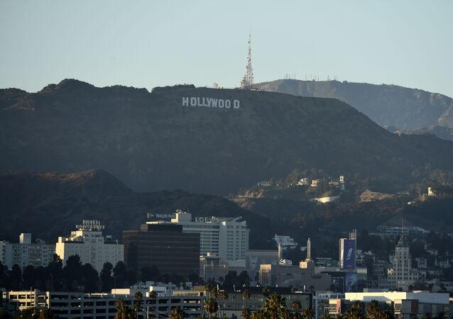 The Hollywood sign is seen above Los Angeles, Friday, July 31, 2020, in Los Angeles.