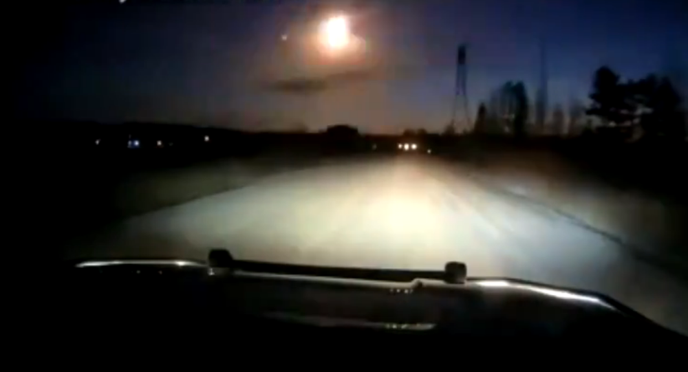 Screenshot from the video taken by Minnesota police sheriff, allegedly showing a meteor falling down from the sky