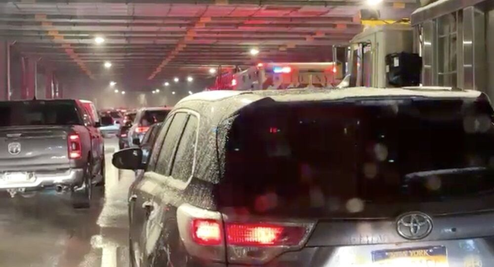 An eyewitness photo of cars lined up on the Henry Hudson Parkway in New York City, from the Citizen app, 16 December 2020.