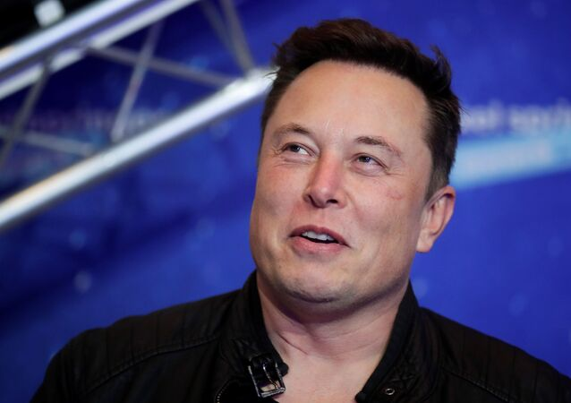 SpaceX owner and Tesla CEO Elon Musk looks on after arriving on the red carpet for the Axel Springer award, in Berlin, Germany, December 1, 2020