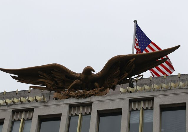 A U.S. flag flies above the Bald Eagle statue by Theodore Roszak atop the  U.S. embassy in London, Monday, Dec. 6, 2010