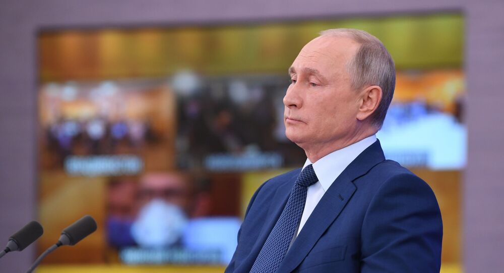 Russian President Vladimir Putin delivers his annual end-of-year news conference, held online in a video conference mode, at the Novo-Ogaryovo state residence outside Moscow, Russia