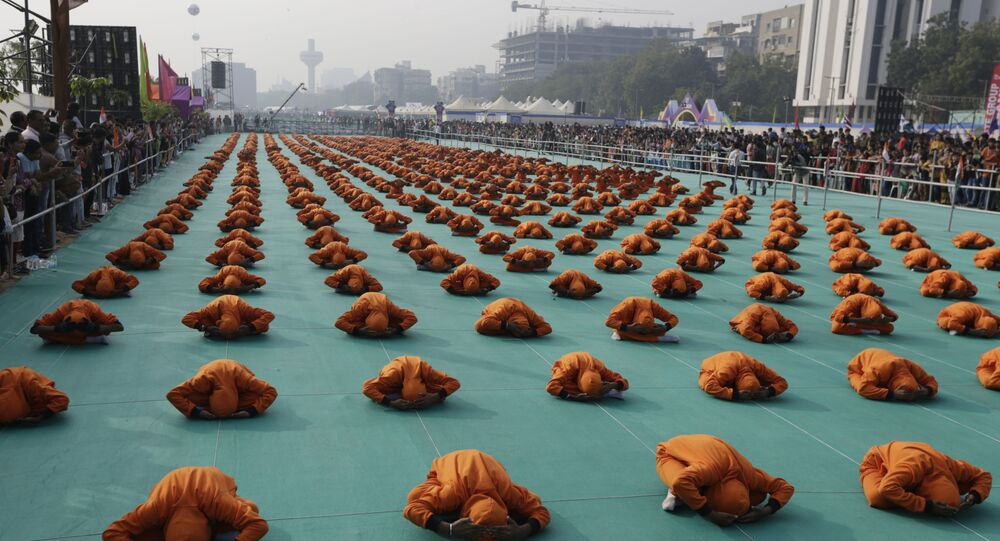 Indian school children perform yoga during the inauguration of an international kite festival in Ahmadabad, India, on Jan. 7, 2020