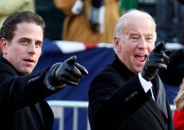 U.S. Vice President Joe Biden (R) points to some faces in the crowd with his son Hunter as they walk down Pennsylvania Avenue following the inauguration ceremony of President Barack Obama in Washington, January 20, 2009.