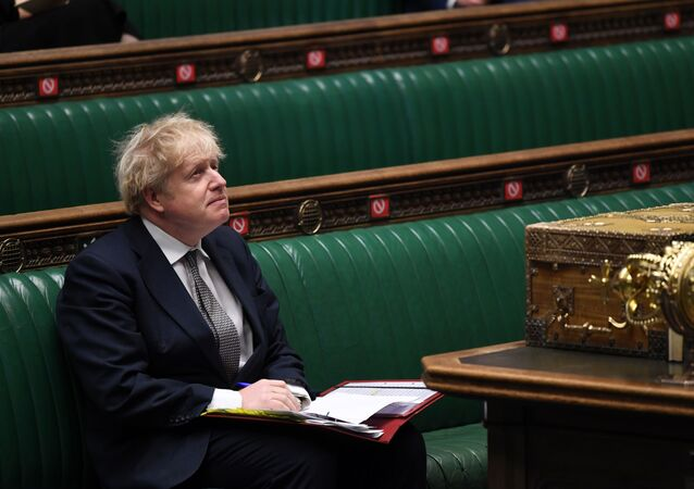A handout photograph released by the UK Parliament shows Britain's Prime Minister Boris Johnson attending Prime Minister's Questions (PMQs), in a socially distanced and hybrid session of the House of Commons, in central London on 16 December 2020
