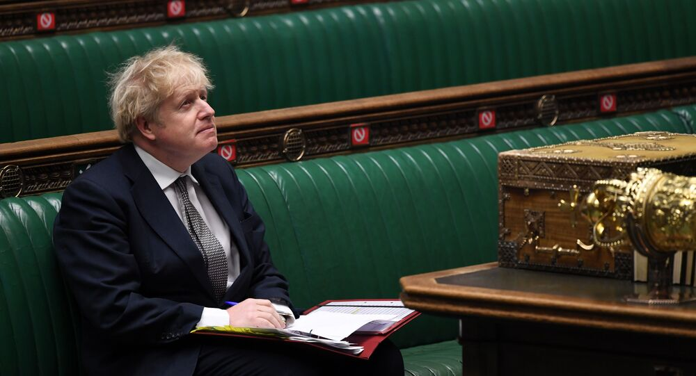 A handout photograph released by the UK Parliament shows Britain's Prime Minister Boris Johnson attending Prime Minister's Questions (PMQs), in a socially distanced and hybrid session of the House of Commons, in central London on December 16, 2020