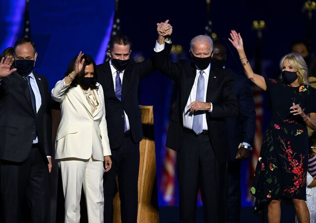 (From L) Husband of Vice President-elect Kamala Harris, Douglas Emhoff, Vice President-elect Kamala Harris, Hunter Biden, US President-elect Joe Biden and wife Jill Biden salute the crowd after delivering remarks in Wilmington, Delaware, on November 7, 2020, after being declared the winners of the presidential election