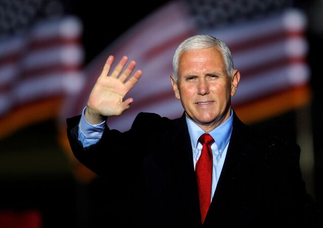 U.S. Vice President Mike Pence waves to supporters at the end of a rally in Kinston, North Carolina, U.S., October 25, 2020