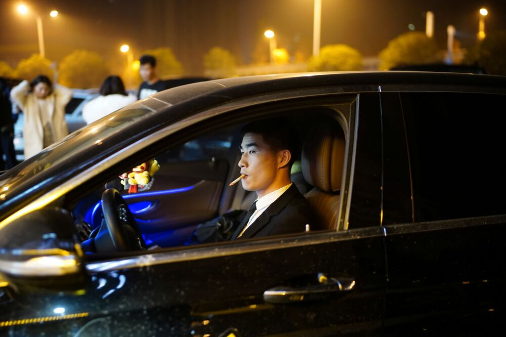 A man drives a car outside a nightclub almost a year after the global outbreak of the coronavirus disease (COVID-19) in Wuhan, Hubei Province, China, 12 December 2020.
