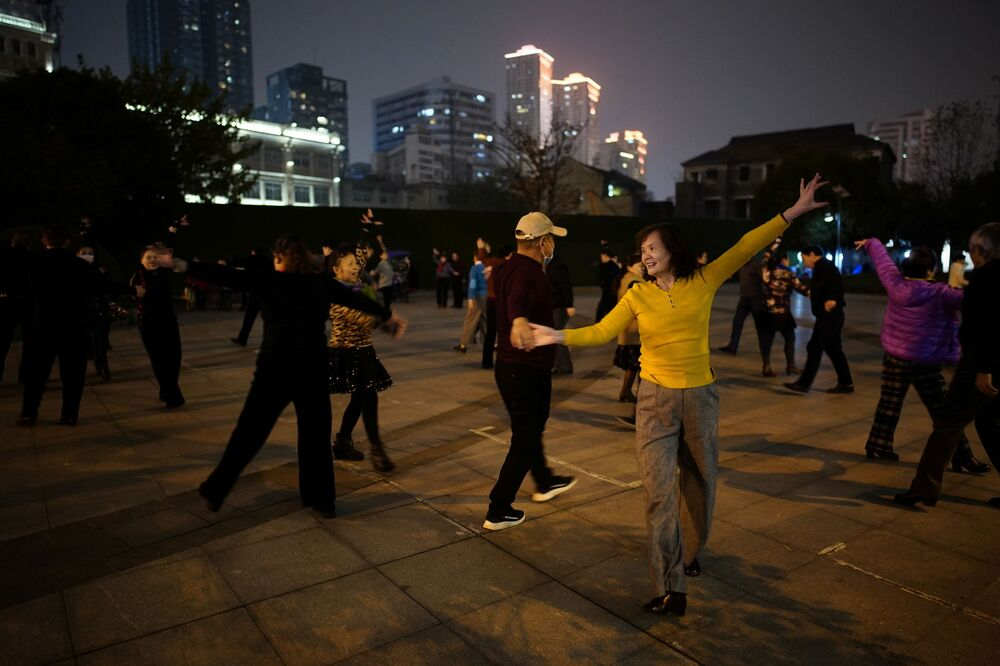 People dance in a park at night almost a year after the global outbreak of the coronavirus disease (COVID-19) in Wuhan, Hubei Province, China, 11 December 2020.
