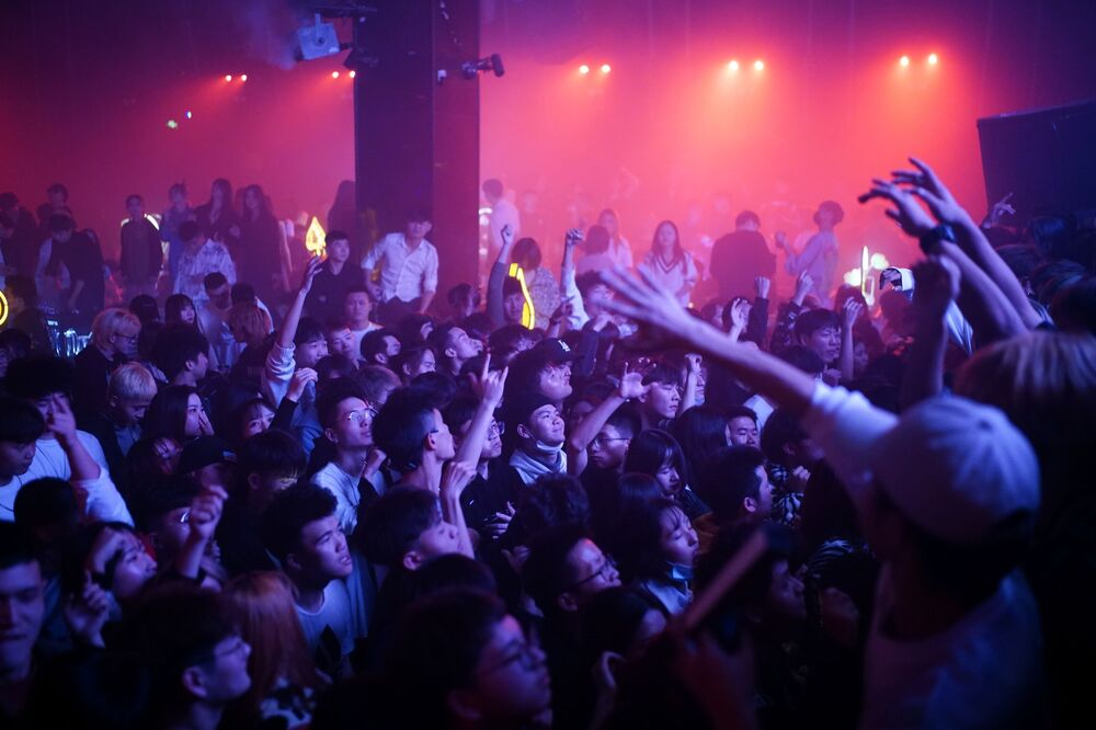 People dance at a nightclub almost a year after the global outbreak of the coronavirus disease (COVID-19) in Wuhan, Hubei Province, China, 12 December 2020.