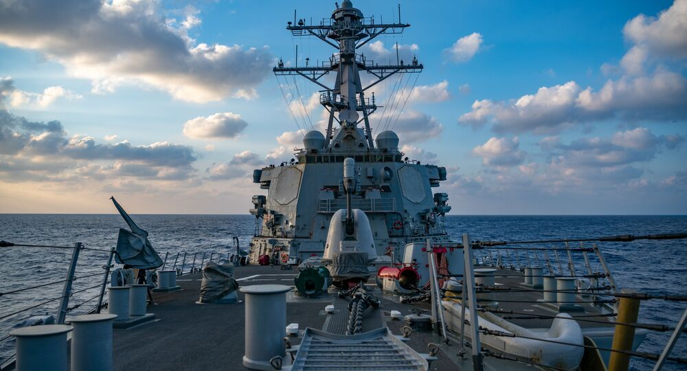 This US Navy photo released April 29, 2020 shows The Arleigh-Burke class guided-missile destroyer USS Barry (DDG 52) conducting underway operations on April 28, 2020 in the South China Sea