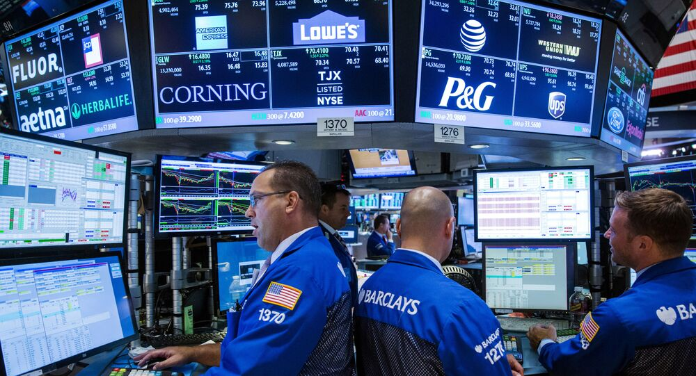 Traders work on the floor of the New York Stock Exchange shortly before the closing bell in New York August 26, 2015.
