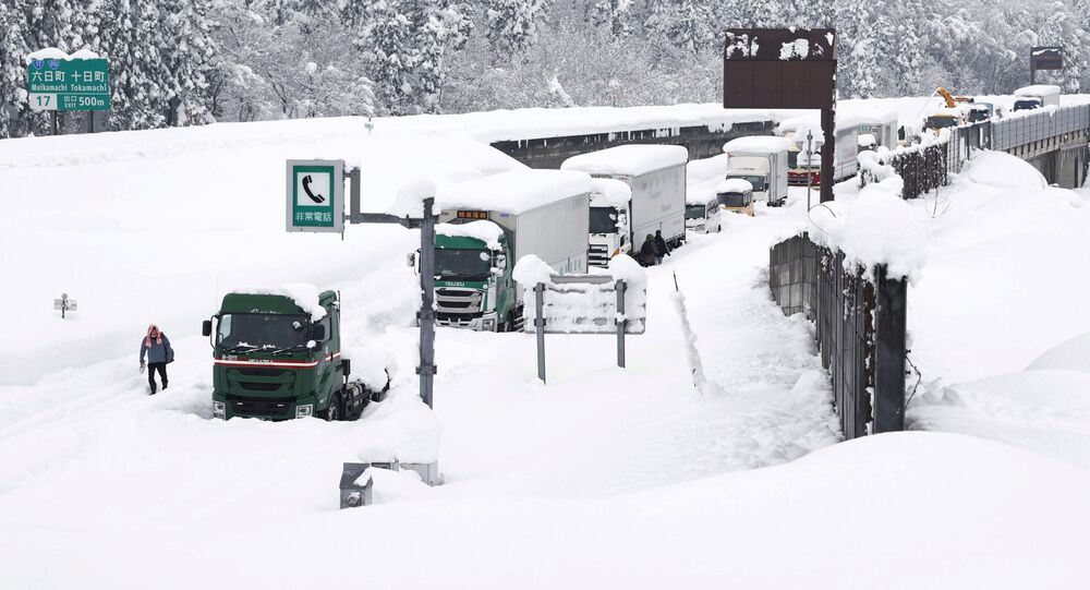 Vehicles are stranded on the snow-covered Kanetsu expressway in Minamiuonuma in Niigata Prefecture, Japan in this photo taken by Kyodo December 18, 2020.