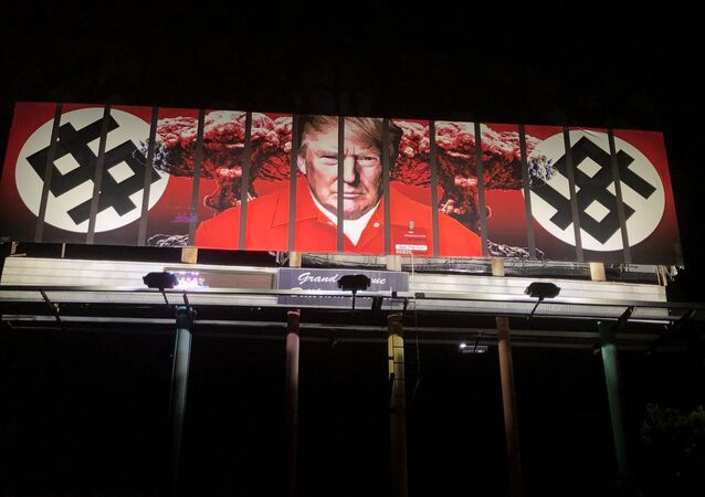 A new billboard in Phoenix shows President Donald Trump behind bars wearing a prison jumpsuit