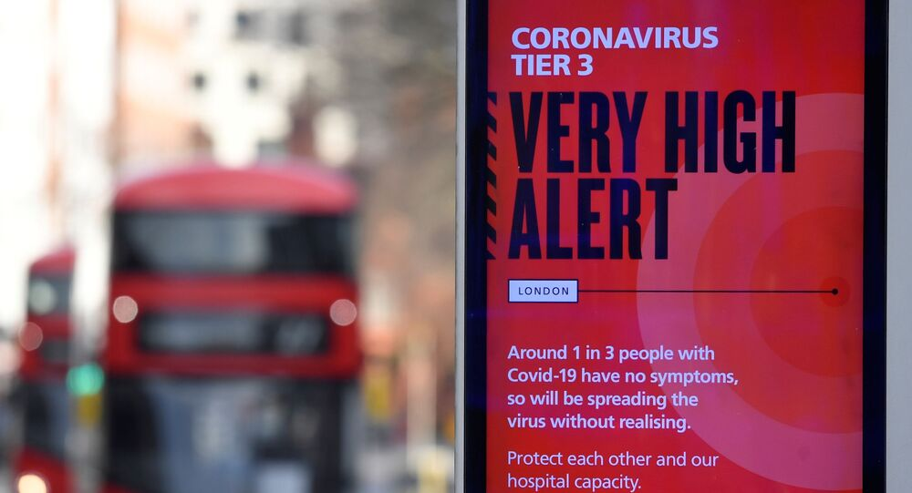 A British government health information advertisement highlighting new restrictions amid the spread of the coronavirus disease (COVID-19) is seen in London, Britain, 19 December 2020.