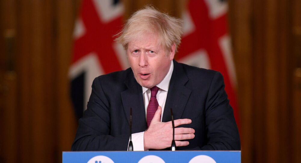 Britain's Prime Minister Boris Johnson speaks during a news conference in response to the ongoing situation with the coronavirus disease (COVID-19) pandemic, inside 10 Downing Street, London ,Britain, December 19, 2020.