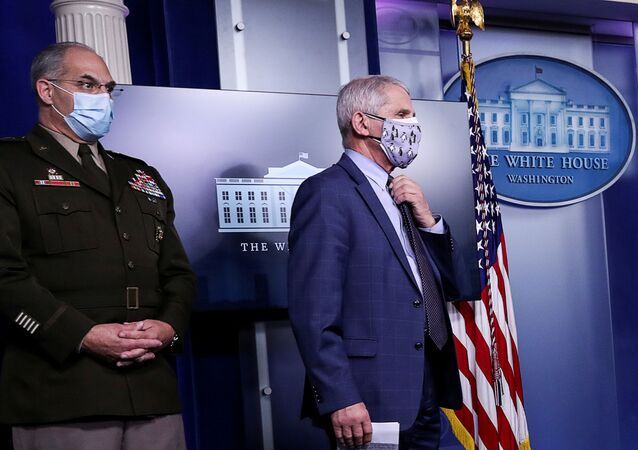 U.S. Army Gen. Gustave Perna, who co-leads the Trump administration effort dubbed Operation Warp Speed to find a vaccine for the coronavirus disease (COVID-19), and Dr. Anthony Fauci, director of the National Institute of Allergy and Infectious Diseases, listen during a briefing by the White House coronavirus task force in the Brady press briefing room at the White House in Washington, U.S., November 19, 2020.