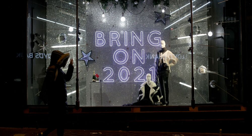 A person walks past a window display at Harvey Nichols in Leeds, Yorkshire, Britain December 19, 2020.