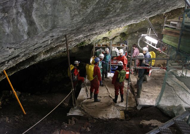 Workers carrying out an excavation at the Atapuerca archaeological site, participating in the '2010 season' of digging, prepare to go down to the Sima de los Huesos on July 21, 2010. The sites in this area were found during excavation of railway cuttings