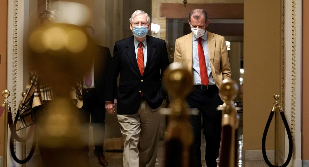 U.S. Sen. Majority Leader Mitch McConnell (R-KY) walks from his office to the Senate floor on Capitol Hill Washington, D.C., U.S. Sunday, December 20, 2020