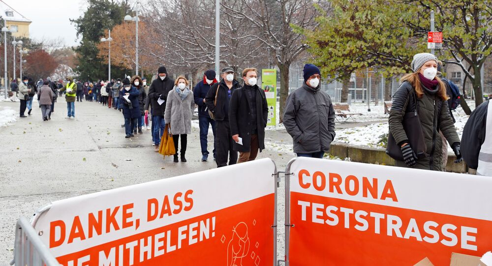 People queue before a mass testing on the coronavirus disease (COVID-19) in Vienna, Austria, December 4, 2020