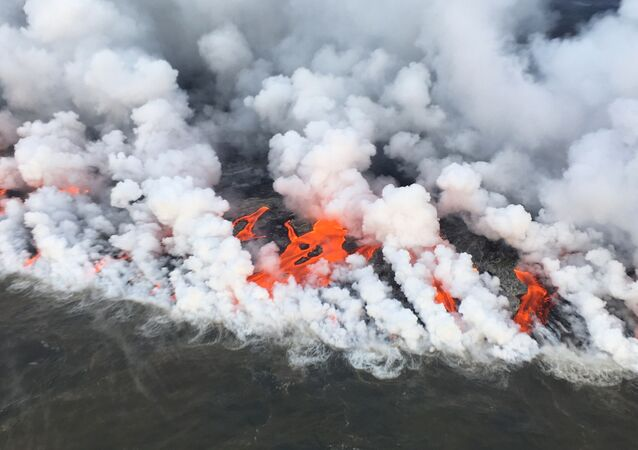 This image obtained June 26, 2018 from the US Geological Survey shows the lava entering the sea and releasing multiple laze plumes at Kilauea Volcano, Hawaii