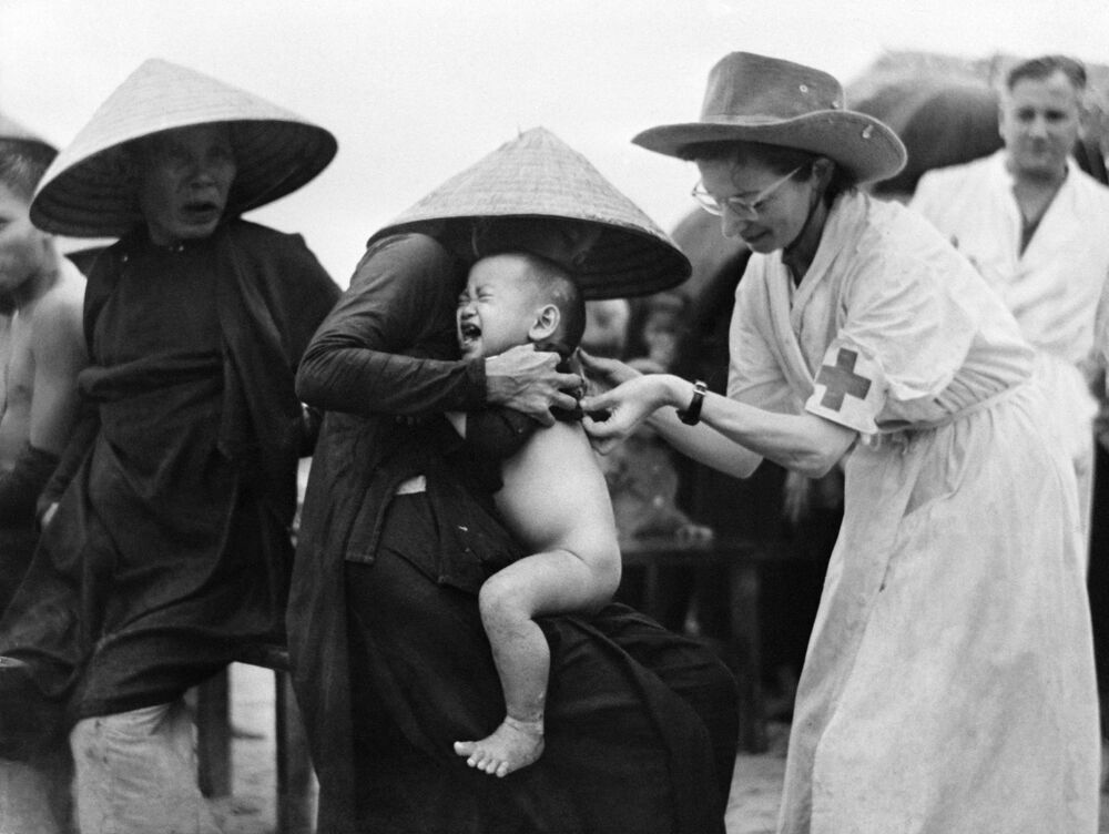 Nurse Marie Josette Francou vaccinates people against cholera in Mong Duc, Indochina on 10 October, 1953.