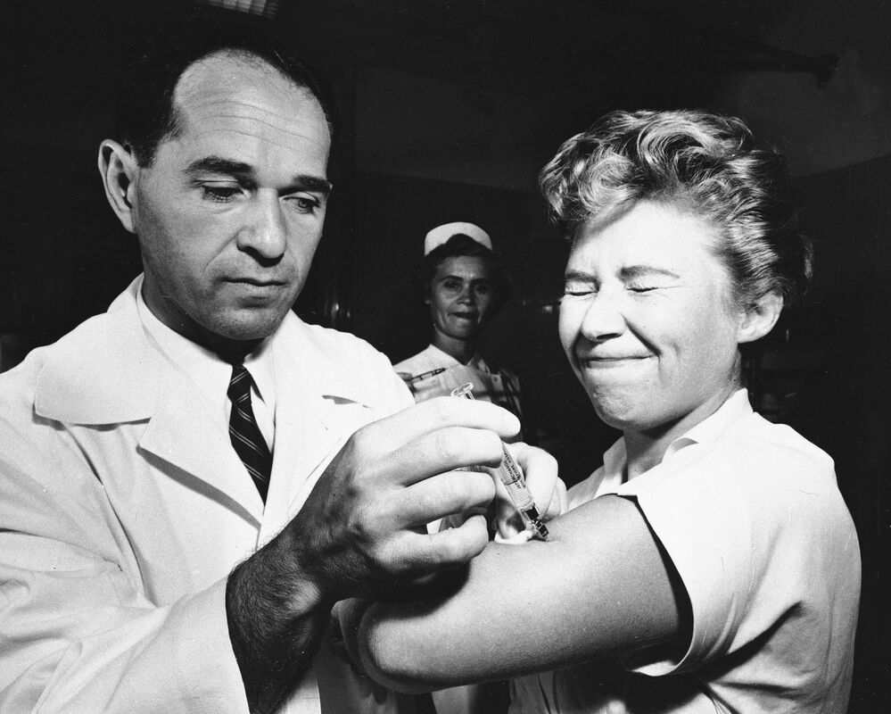 Taken on 16 August, 1957, this photo shows Dr. Joseph Ballinger giving Marjorie Hill, a nurse at Montefiore Hospital in New York, the first Asian flu vaccine shot administered in the city.