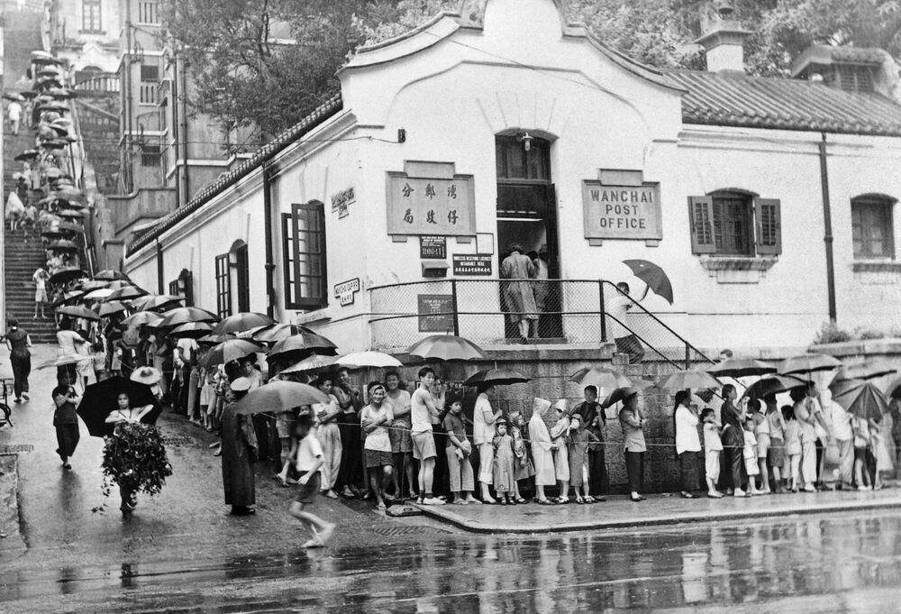 People queue on 1 September 1961 to be vaccinated against cholera in front of a medical centre in Hong Kong.