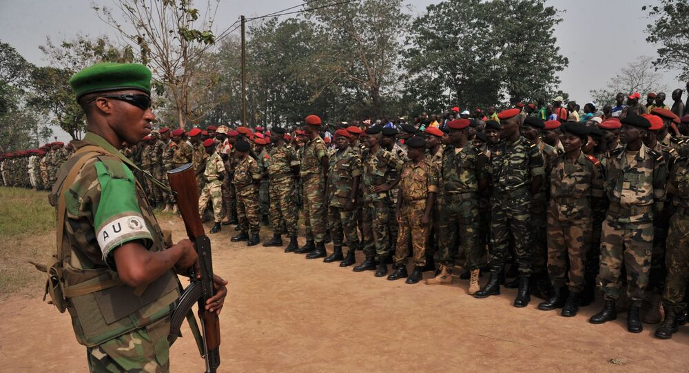 A Rwanda's soldier of the Misca stands guard as members of the Central African Armed Forces (FACA) listen to interim president Catherine Samba Panza's speech on February 5, 2014, in Bangui during a military ceremony