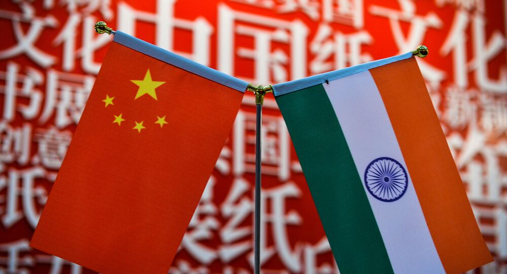 The national flags of India (R) and China are seen at the Delhi World Book fair at Pragati Maidan in New Delhi on January 9, 2016.