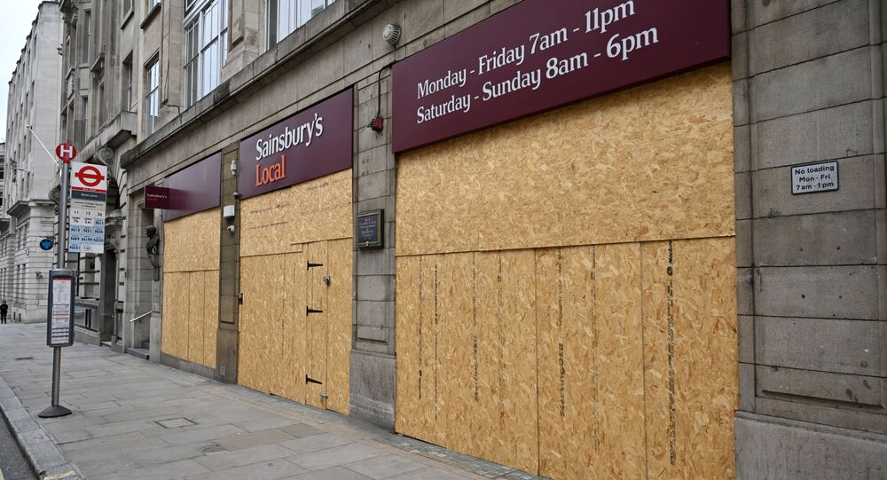 The boarded-up front of a Sainsbury's Local supermarket is pictured on Fleet Street in central London on May 3, 2020, during the nationwide lockdown due to the novel coronavirus COVID-19 pandemic.