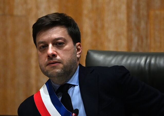 Socialist Party's new mayor of Marseille Benoit Payan wearing the mayor's scarf looks on during the handover of power ceremony in Marseille on December 21, 2020.