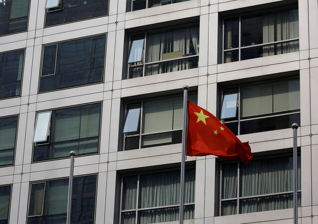A Chinese national flag flutters near the building of China Securities Regulatory Commission (CSRC) at the Financial Street area in Beijing, China July 16, 2020.