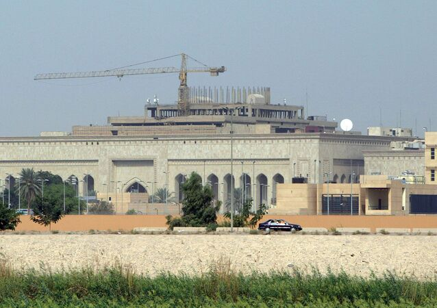 This file photo taken on October 11, 2007 shows in the forefront the US embassy complex in Baghdad and in the background, cranes towering over the construction site of the International High Tribunal (IHT) courthouse, in the heavily fortified Green Zone, on the west bank of the Tigris River in Baghdad