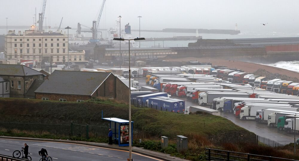 Freight lorries and goods vehicles are pictured parked in a paring lot near the Port of Dover in in Dover, Kent, on the south east coast of England on December 21, 2020