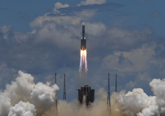 A Long March-5 rocket, carrying an orbiter, lander and rover as part of the Tianwen-1 mission to Mars, lifts off from the Wenchang Space Launch Centre in southern China's Hainan Province on July 23, 2020