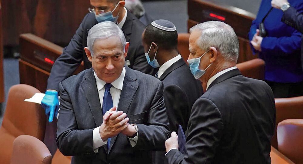 A handout picture released by the Israeli Knesset (parliament) spokesperson's office on May 17, 2020, shows Israeli Prime Minister Benjamin Netanyahu (L) and alternate PM Benny Gantz, during the swearing-in ceremony of the new government in Jerusalem