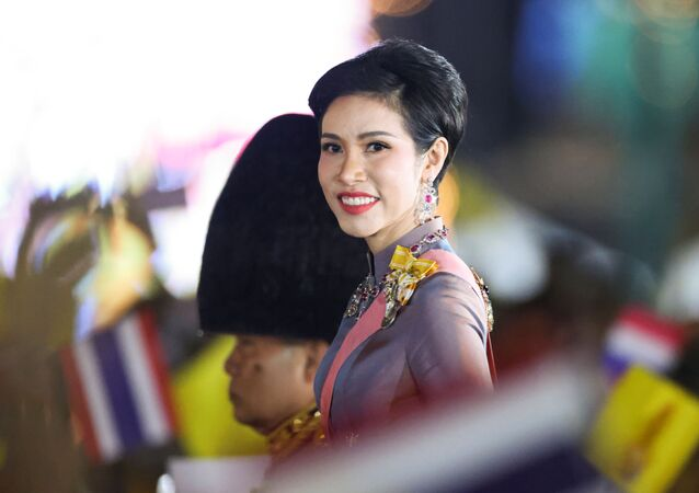 Thailand's Royal Noble Consort Sineenat Wongvajirapakdi attends a candlelight vigil to remember the birthday of Thailand's late King Bhumibol Adulyadej, outside the Grand Palace in Bangkok, Thailand, 5 December 2020