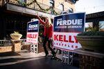 Senator Kelly Loeffler (R-GA) arrives on the stage during a campaign event with Senator David Perdue (R-GA) and White House senior advisor Ivanka Trump (not pictured) at the Olde Blind Dog Irish Pub, in Milton, Georgia, U.S., December 21, 2020