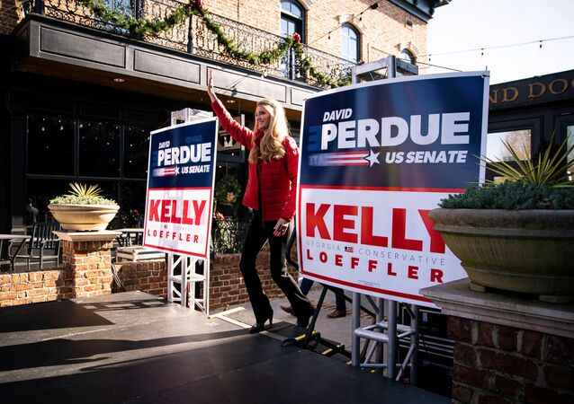 Senator Kelly Loeffler (R-GA) arrives on the stage during a campaign event with Senator David Perdue (R-GA) and White House senior advisor Ivanka Trump (not pictured) at the Olde Blind Dog Irish Pub, in Milton, Georgia, U.S., December 21, 2020