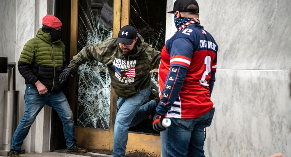 Protesters break the door to the Capitol building during a protest against restrictions to prevent the spread of coronavirus disease (COVID-19) in Salem, Oregon, US, 21 December 2020.